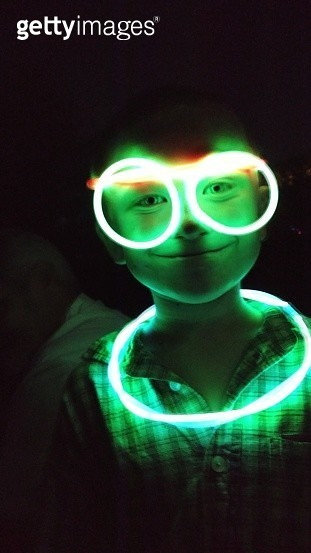 Portrait Of Boy With Illuminated Neon Ring And Eyeglasses In Darkroom - gettyimageskorea