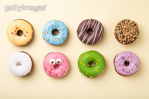 Top view of set of donuts on yellow background. Flat lay, copy space. - gettyimageskorea