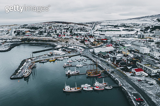 Scenic aerial view of port with old ships in Husavik, in winter - gettyimageskorea