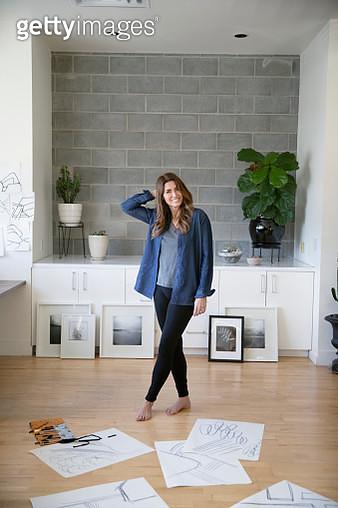 Portrait confident female artist sketching in studio - gettyimageskorea
