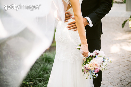 Bride and groom hugging - gettyimageskorea