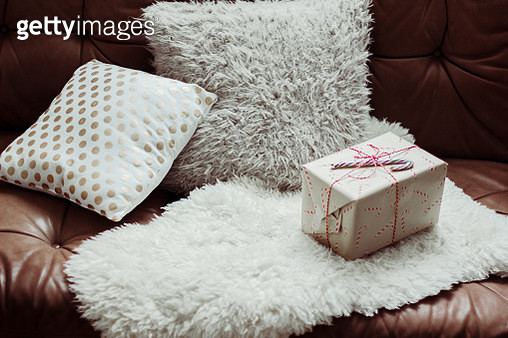 Gift Box And Pillows On Sofa In Living Room At Home - gettyimageskorea
