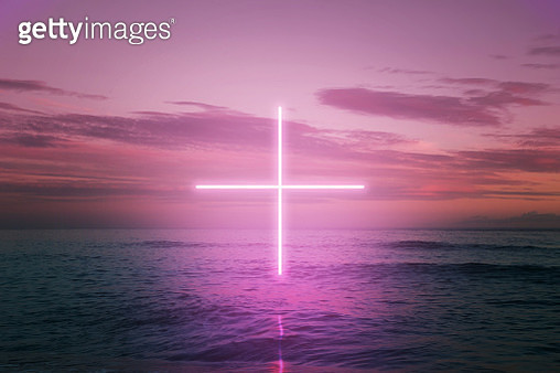 Creative picture performance of digital neon cross in the middle of the sea with sunset sky. - gettyimageskorea