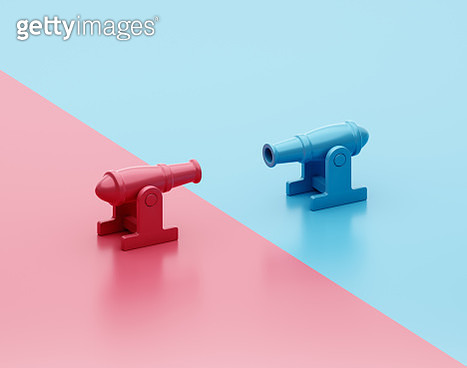 A red and a blue cannon aiming at each other - gettyimageskorea