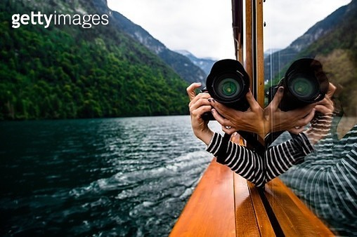Woman Photographing Mountain - gettyimageskorea