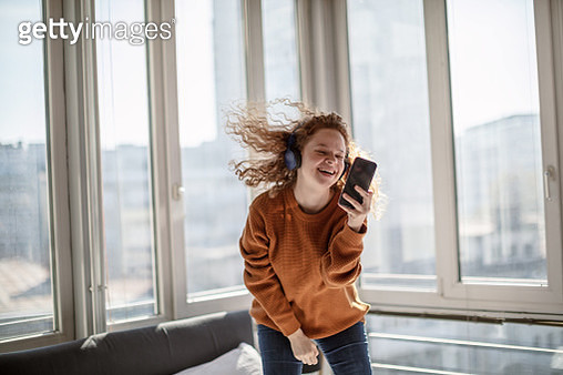 Listening music and jumping at bed - gettyimageskorea