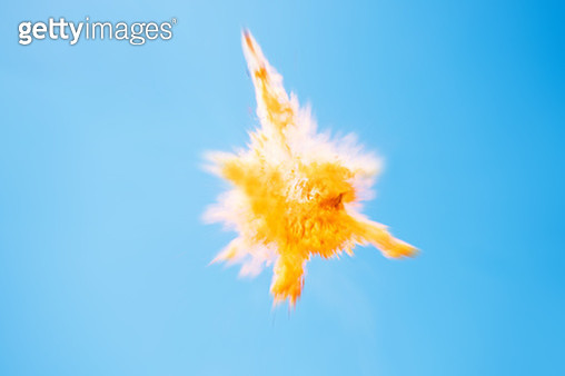 Yellow particle explosion. - gettyimageskorea