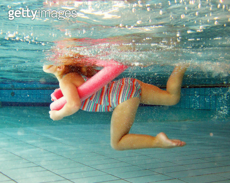 Young Girl Swimming at the Pool - gettyimageskorea