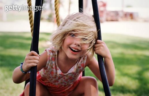 Young girl on swing - gettyimageskorea