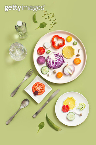 Minimalist style healthy eating colourful sliced vegan food served on coloured background. - gettyimageskorea