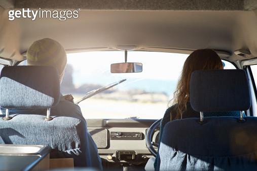 Couple driving in camper van. - gettyimageskorea