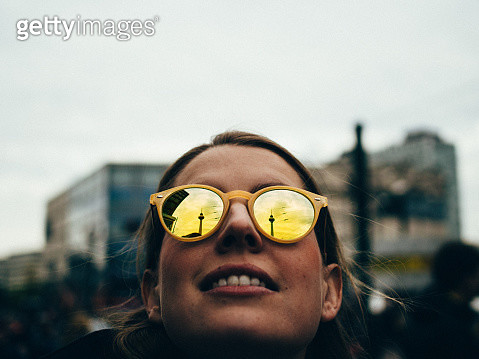 Close-Up Of Woman Wearing Sunglasses Against Sky - gettyimageskorea