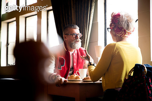 Quirky couple relaxing in bar and restaurant, Bournemouth, England - gettyimageskorea