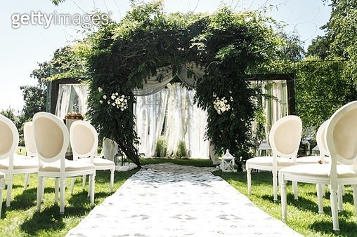 Wedding arch decorated with greenery outdoors - stock photo - gettyimageskorea