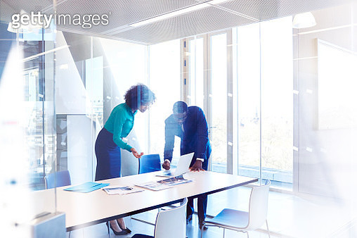 Colleagues in meeting room discussing project - gettyimageskorea