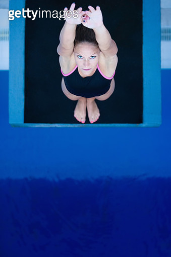 High Angle View Of Woman Diving Into Swimming Pool - gettyimageskorea