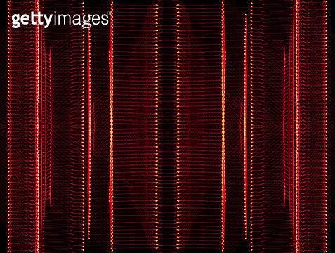 Close-up abstract pattern of intertwined colorful light beams of color red on a  black background. - gettyimageskorea