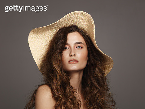 Beautiful young woman wearing summer hat - gettyimageskorea