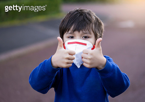 Portrait Of Boy Wearing Mask Gesturing Outdoors - gettyimageskorea