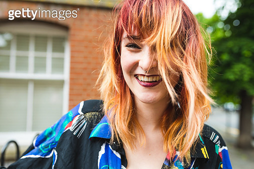 Portrait of young woman with dip dyed hair laughing - gettyimageskorea