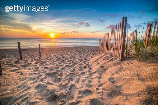 Sandy beach and Atlantic Ocean at sunrise, Outer Banks, North Carolina, USA - gettyimageskorea