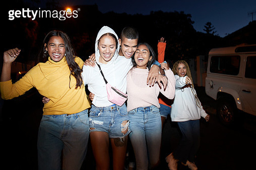 Happy young friends dancing at night - gettyimageskorea