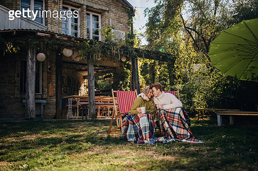 Lovely carefree couple enjoying their cozy time together - gettyimageskorea