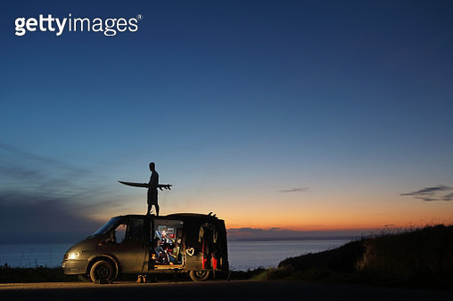Young adults with camper van at sunset - gettyimageskorea