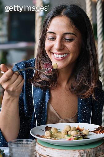 Woman enjoying vegetarian dish - gettyimageskorea
