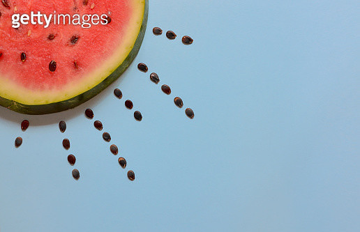 High Angle View Of Watermelon Slice With Seeds Over Blue Background - gettyimageskorea