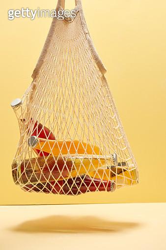 Soda bottles in mesh bag - gettyimageskorea
