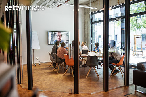 Business people video conferencing in board room - gettyimageskorea