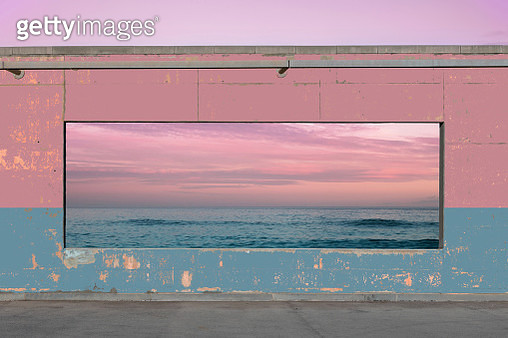 Panoramic window in colorful concrete wall matching with the seascape sunset view. - gettyimageskorea