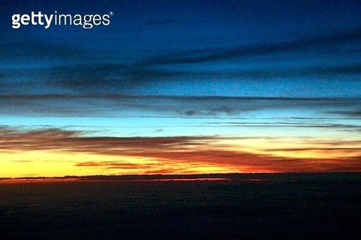 Nature's Building Blocks: An aerial view of colorful clouds and ethereal patterns in the sky at sunset - gettyimageskorea