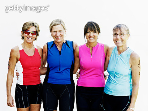 Group of four female triathletes standing smiling - gettyimageskorea