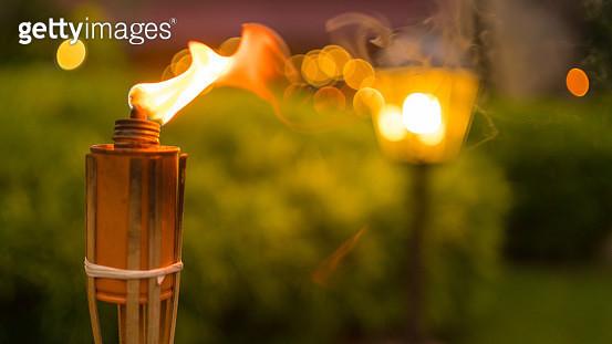 Close-up on flame of bamboo torch  prepare for Hari Raya Aidilfitri  celebration - gettyimageskorea