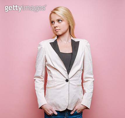 Young woman on wearing blazer on pink background - gettyimageskorea
