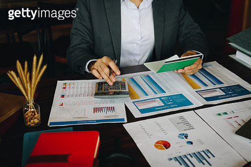 Midsection Of Businesswoman Working At Desk - gettyimageskorea