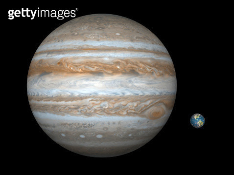 Artist's concept comparing the size of the gas giant Jupiter with that of the Earth. - gettyimageskorea