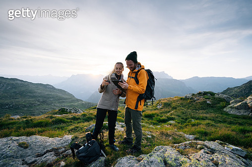 They are backlit in the morning light and layers of mountains behind them, Chamonix - gettyimageskorea