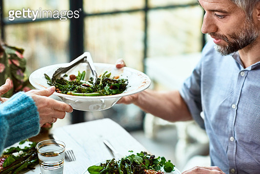 Close up shot of mature man being served fresh salad - gettyimageskorea