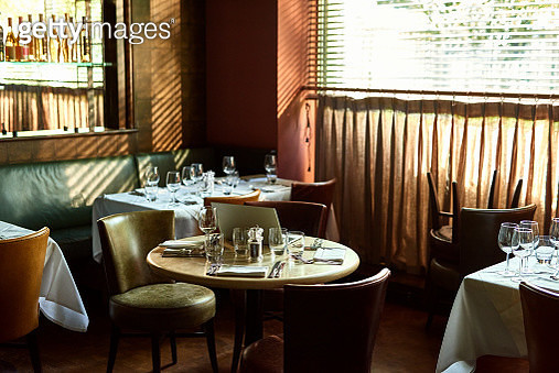 Restaurant interior with laptop on table - gettyimageskorea