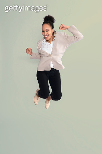 business woman jumping - gettyimageskorea