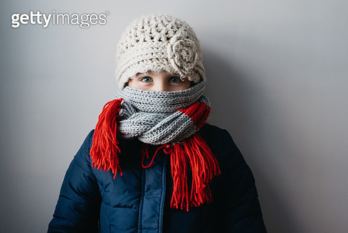 Girl warmly wrapped up in woollen hat and scarf - gettyimageskorea