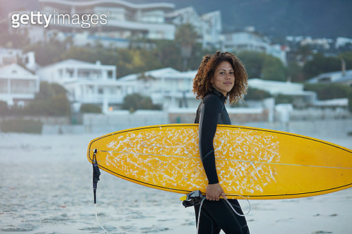 Surfer walking with board on the beach - gettyimageskorea