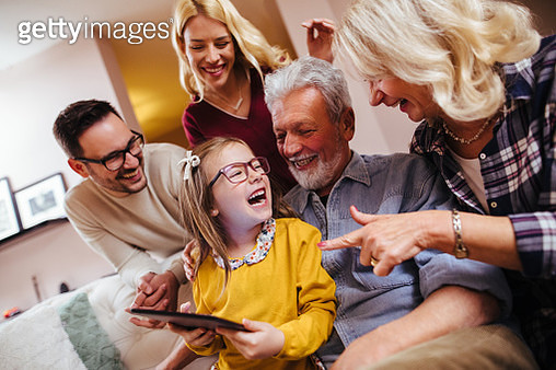 Multi-generation family using digital tablet at home - gettyimageskorea
