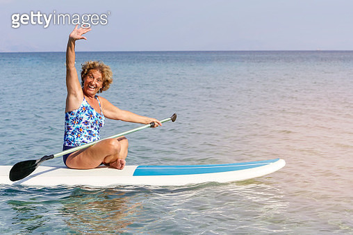 Portrait of senior woman surfer on the sea - gettyimageskorea