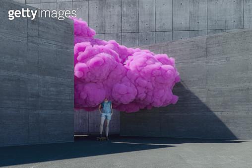 Young woman brainstorming in pink cloud - gettyimageskorea