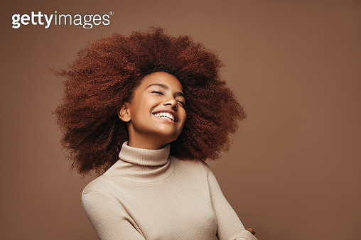 Photo of cheerful curly girl with positive emotions - gettyimageskorea