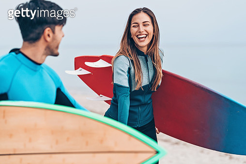 Happy couple of surfers - gettyimageskorea